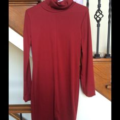 Deep red turtleneck tunic Knit material. Never been worn- fits slim through hips, straight in cut. Deep red. Tops Tunics