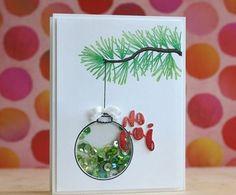carte de noel a fabriquer, boule de noel, décorée de paillettes verts suspendue à une branche de pin dessiné