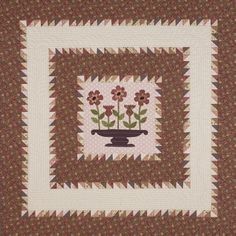 Bring spring into any space with this appliqué wall hanging. Use freezer paper to prepare pieces for machine appliqué.