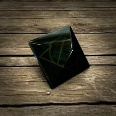 This is a model of the Resurrection Stone from the Harry Potter books and movies. Scorpius Malfoy, Draco Malfoy, Luna Lovegood, Stone Tattoo, Under The Shadow, Lord Voldemort, Harry Potter Books, Deathly Hallows, Dark Art
