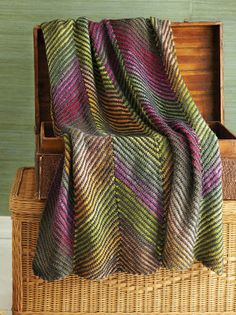 knitted blanket by Noro. love the look. wondering if can achieve same look with Tunisian crochet....
