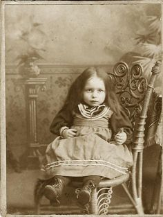 child on wicker chair - adorable