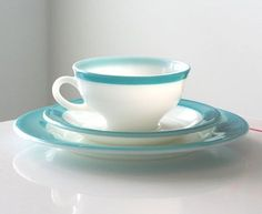 White and turquoise cup and saucer pyrex set