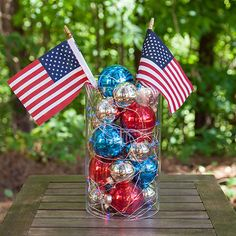 Create a patriotic centerpiece using red and blue fairy lights, Christmas ornaments and American flag decorations!
