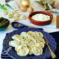 Pelmeni are Russian dumplings with a juicy meat filling, classic Russian comfort food. It's found in every Russian's freezer, and around the former Soviet States. It's part of the group of Eastern European dumplings like Vareniki, Pierogies, Uszka, and even Manti. Traditionally served with sour cream and fresh dill.