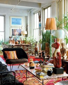 eclectic // marble coffee table, oriental rug, floor lamp, african mask, windsor chairs, dining table, dining space, living space, living room