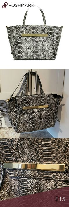 """Trendy Snake Print Bag! This tote features a foldover front with slip closure, an adjustable shoulder strap and two top handles. Grey embossed snake this luxe print will make you a trendsetter!  This bag has been lightly used. Only wear is slight scratching on gold bar (pictured).  Bag Details Material: Faux Leather Size: 12.5L x 10H x 6D Hardware color: Gold Shoulder drop measurement : 6"""" Removable Adjustable Shoulder Strap Pockets: 1 exterior zip, 1 interior pocket, 1 interior zip Closure…"""