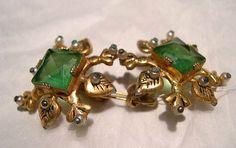 Earrings Designer: Mr. Omar Kiam Date: 1942 Culture: American Medium: imitation stones, gilt metal