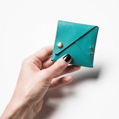 Powder Blue Kangaroo Leather Origami Purse! Flipped, folded & formed into a purse made just the right size for your coins and small things! Carry your trinkets, spare change or keep your earbud headphones from tangling. Inspired by the art of paper folding, this Origami Purse is hand