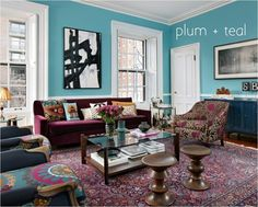 Eclectic living room in rich plum purple and teal blue. Designed by Kati Curtis Design.