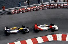 Ayrton Senna (BRA) McLaren MP4/7A manages to stay ahead of Nigel Mansell (GBR) Williams FW14B in a fierce battle at the end of the race. Monaco Grand Prix, Monte-Carlo, 31 May 1992