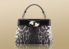 "Bulgari ""I. Rossellini"" handbag in pony calf leather in animalier black & white. 35103"
