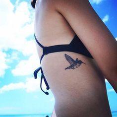 Side tattoo of a small hummingbird. Tattoo artist: Hongdam