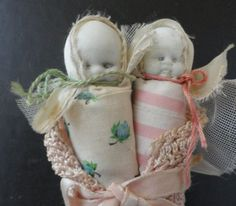 Two Bisque Babies Inside a Knitted Baby Booty Antique 1800's Small
