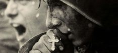 A Soviet Soldier kissing his cross before going into battle during the Battle of Kursk. -Battle of Kursk Part 3 Final Part- Lourdes, Holy Rosary, War Photography, Emotional Photography, Popular Photography, White Photography, Street Photography, Landscape Photography, Photography Ideas