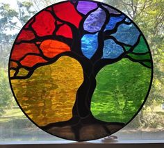 This multi-color waterglass Tree of Life panel is 21 diameter. It comes with rings and chain installed for immediate hanging. It can be made