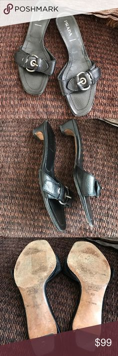 Authentic Prada Black leather buckle slides Gorgeous preowned Prada a bargain price! Shows little to no wear except for on the soles. The perfect basic black slide that you will wear all summer! Please know that these are very roomy! My feet are more on the wide side and I have trouble fitting into some designer shoes but these fit just fine are very roomy and comfortable! Prada Shoes Heels