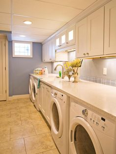 With not just one washer and dryer but two, designer Shane Inman ensures a low turnover rate for laundry in this household. By encasing the units below a stone countertop and adding storage cabinets above, the room instantly expands its functionality and efficiency.