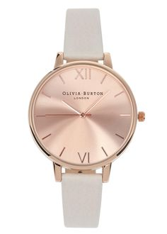 Olivia Burton rose gold plated watch Designer stamped face, three hand Japanese quartz movement Buckle fastening strap Comes in a designer stamped box