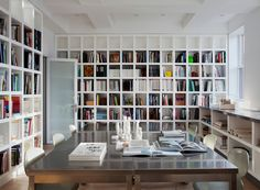Storage Walls — the Space-Saving Workhorses of Design. A storage system like this one makes the most of wall real estate. If you are keeping the shelves exposed, an evenly spaced grid is a beautiful way to create harmony in what could otherwise be a chaotic composition. Bonus points for organizing your bookshelves by color.