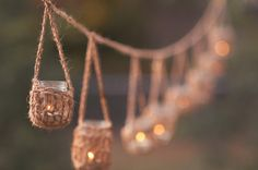 This garland of rustic mason jar hangers would be perfect for a wedding.