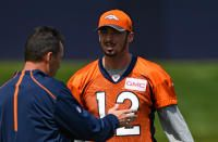 Denver Broncos quarterback Paxton Lynch (12) talks with head coach Gary Kubiak during rookie minicamp May 6, 2016 at UCHealth Training Facility.