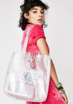 Skinnydip Fairy Dust Tote Bag cuz you're one magical b*tch! This tote bag has a clear glittery body, two top handles, and lots of room inside for everything you need.