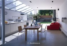 Modern conversion and extension. (Living area) - patio glass extension lean-to terrace