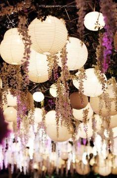 Hanging lanterns and flowers for boho wedding reception decor