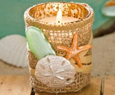 This DIY Beachy Mason Jar Candle Holder is a fun way to incorporate mason jars into your wedding decor. In just eight steps, this tutorial will show you how to create this gorgeous DIY candle holder that would make a perfect decoration for a beach we