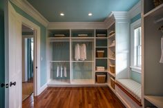 Spacious and luxurious, the oversized walk-in master closet provides ample storage for year-round wardrobes. Custom-built shelving and crown molding draws attention to the thoughtful craftsmanship that takes this closet design to the next level. #HGTVDreamHome