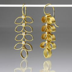 """These intricately handcrafted Barbara Heinrich earrings are playful, bold and elegantly unique. The 18K yellow gold cellular leaves dangle dramatically and hold within them 8 white diamonds. The sparkle and the creative whimsy in these earrings are a wonderfully artistic addition to your collection!<br><br>Diamonds = .16cttw<br>Total length measures 1 7/8"""""""