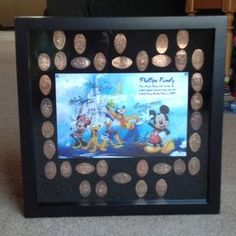 """Disney smashed pennies displayed in a shadow box.  We loved finding places to smash pennies around Disney World, I had to find a way to display all our """"treasures"""" :)"""