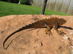 Iguana Yard Art, Small Freehand plasma cut from recycled metal. The metal is finished with a hand applied oxidation. Indoor or Outdoor. Metal Yard Art, Metal Tree Wall Art, Scrap Metal Art, Metal Artwork, Metal Sculpture Artists, Steel Sculpture, Sculpture Ideas, Art Sculptures, Sculpture Stand