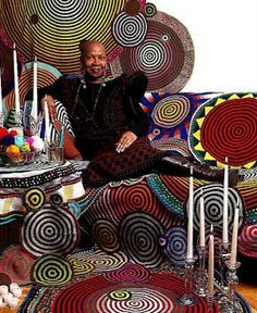 Originally from Seattle, Washington, and now living in Harlem, New York, Xenobia Bailey brings African American roots music into visual terms with vibrant room-sized installations of crocheted mandalas, tents, and costumes.