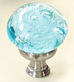 A flattened globe and swirling bubbles impart a handmade look in this Aqua Glass Bubble Knob. Just $7.98 for two; World Market