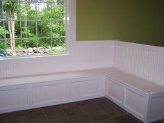 Built in bench seating for south wall in rec room. Possible storage option for games, etc. as well. (found at http://www.diythisnthat.com/2008/06/18/building-a-seating-bench/)