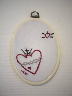 """PLEASE DON'T COPY available on #etsy:  Number 9, Sacred hearts ex-votoes handmade embroidery 5.5"""" / 14 cm off-white hoop . Religious hand embroidery fiber art wall art handmade embroidery 5.5"""" / 14 cm hoop #embroidery #sacredheart #religiousart #fibertart #exvoto #parisianpastelstitches  #arttextile #handembroidery"""