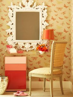 After Makeover: Add Storage  In the nook, tucking the pink drawer unit under the acrylic table provides space to store supplies for the morning routine. The butterfly-pattern wallpaper outlines the nook and vividly accents the color scheme.