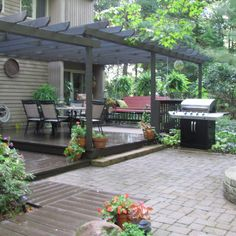 A tiered deck is made more cohesive and comfortable with the addition of a pergola that unites both levels. | thisoldhouse.com/yourTOH