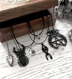 """Always 10% off with code """"insta"""" on all your witchy favourites #crystals #quartz #quartznecklace #choker #moonchoker #sterlingsilver #silver #pentagram #pentacle #pentagramchoker #onyx #witch #witchy #witchnecklace #scarab #beattle #restyle #restylenecklace #rogueandwolf #allseeingeye #occult #pagan #hellaholics"""