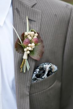 Modern rustic Boutonniere. Fun Galex leaves and berries boutonniere Olivia Gird Photography