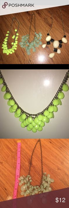 Statement fashion necklace (Lot of 3) These necklaces will add flair to any outfit. Getting all three is a bargain! 💕 Necklace 1 - Neon statement with shorter length 💕 Necklace 2 - Foam green with shorter length 💕 Necklace 3 - Large statement with black & white with longer chain. Jewelry Necklaces