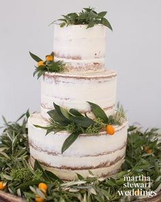 """I was obsessed with kumquats,"" jokes Louise about the orange fruit, which adorned the cake and reception tables."