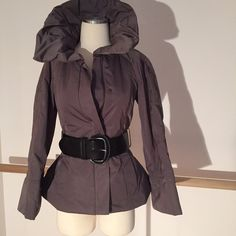 🍃💋Brrr.. Flirty, Feminine, Fun waterproof Jacket A sexy subtle  modern interpretation of Victorian skirts in a Winter coat ... Pretty shade of Taupe, very chic with stay-up petal collar for warmth and sassîness..Zip closure with snap buttons .The lower back and sides are super sexy giving a flirty Pouf effect that you can play up or down, fully lined, pockets.  Belt is not included, no loops, just 4 the photo. I have it listed separately, used maybe twice. Immaculate condition🍃💋 labeled…