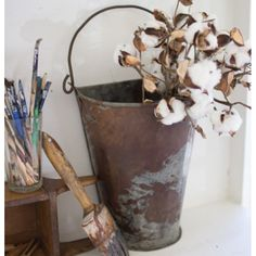 "This metal wall bucket features a beautiful rusty antiqued finish with top handle and is perfect for displaying fresh flowers with a farmhouse touch to an entryway, bathroom or kitchen. Measures 9""W x 11.5""H x 6.5""D"
