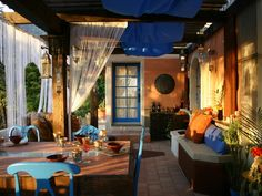 One of the best ways to show off a color is to combine it with its complementary hue. In this Moroccan design, Kim Myles uses orange and blue, which sit across from each other on the color wheel, to create a vibrant, energetic outdoor living space.
