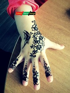 Another diagonal mehndi designs with Pakistani traditional having dark pattern and color with flowers. With beautiful butterfly wondering over the flowers.  http://www.latesthennadesigns.com/2017/05/15-simple-mehndi-designs-for-kids.html  #henna #hennadesigns #hennaforkids #forlove #forkids #mehndi #mehndidesigns