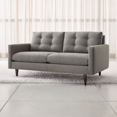 Petrie is a grandly scaled three-seat sofa that sits at the intersection of mid-century and today, with clean lines and tailored cushions expertly button-tufted by hand. Mid Century Sectional, Mid Century Modern Loveseat, Apartment Sofa, Apartment Living, Tufted Sofa, Sectional Sofa, Couches, Transitional House, Living Room Sofa
