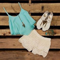 I love the color of the crop-top and the design. The shorts are just awesome! The sandals are a great finishing touch, also.